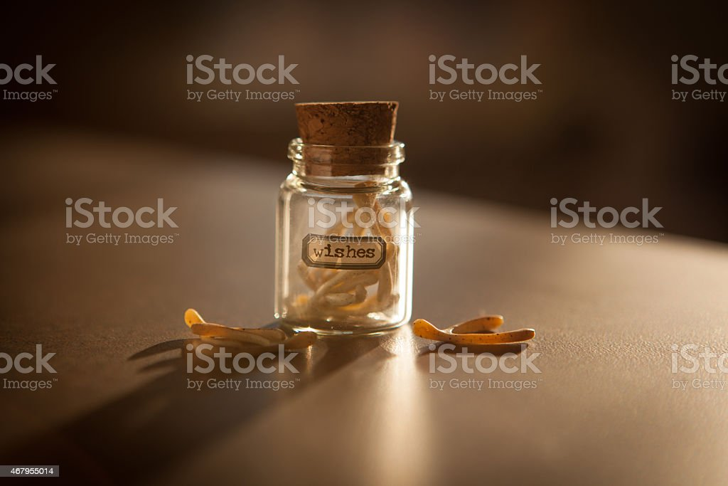 Jar of miniature wishbones labelled Wishes. stock photo