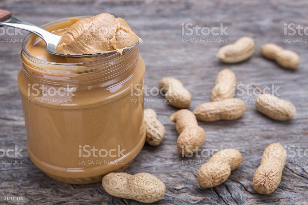 Jar of peanut butter with nuts. stock photo