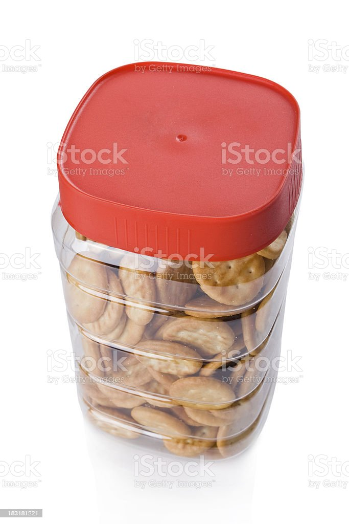 Jar of small appetizer crackers isolated on white background royalty-free stock photo