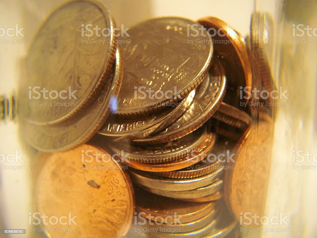 Jar of Stacked Assorted Coins stock photo