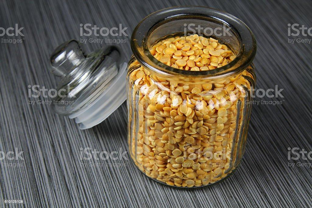 Jar of yellow lentils stock photo