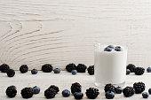 Jar of yogurt with blueberries and blackberries