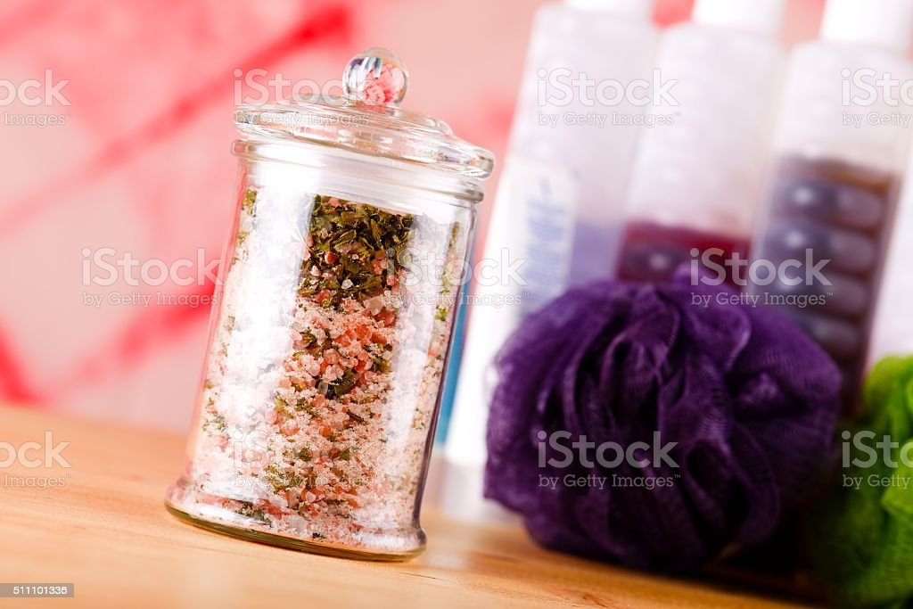 Jar with bath salt askew placed on wooden board stock photo