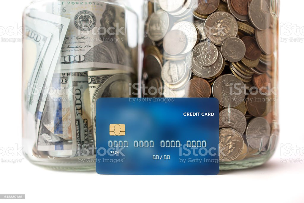 jar with coins and money, credit card stock photo