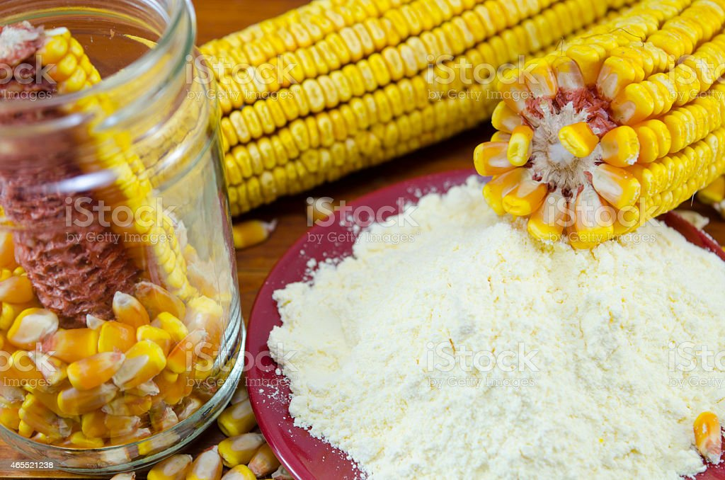 Jar with corn, flour and corn ear royalty-free stock photo