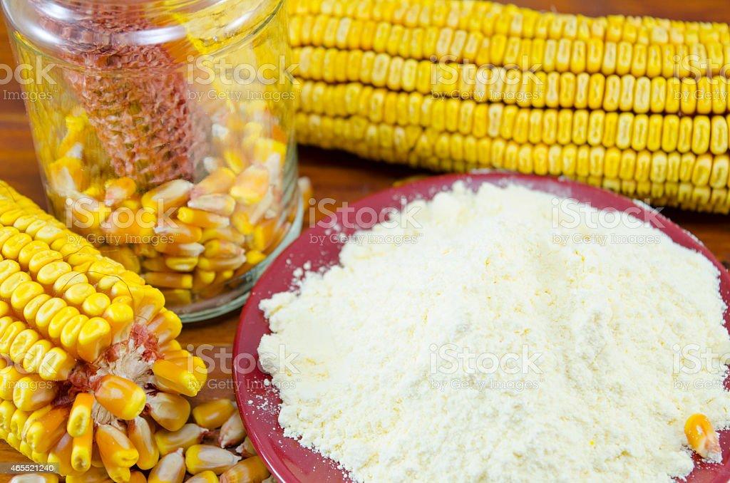 Jar with corn, flour and corn ear royalty-free stock photo