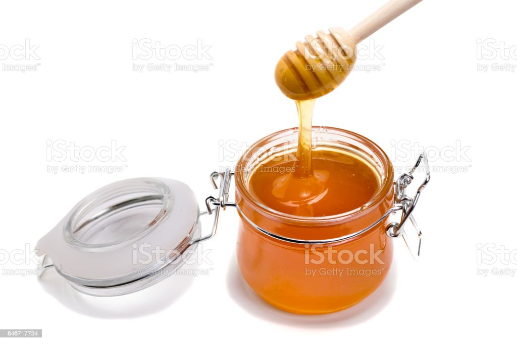 jar with lid with honey on white background stock photo