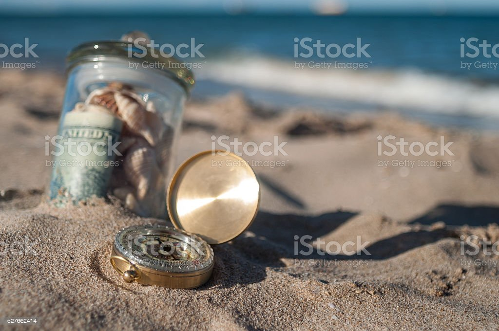 jar with money and compass stock photo