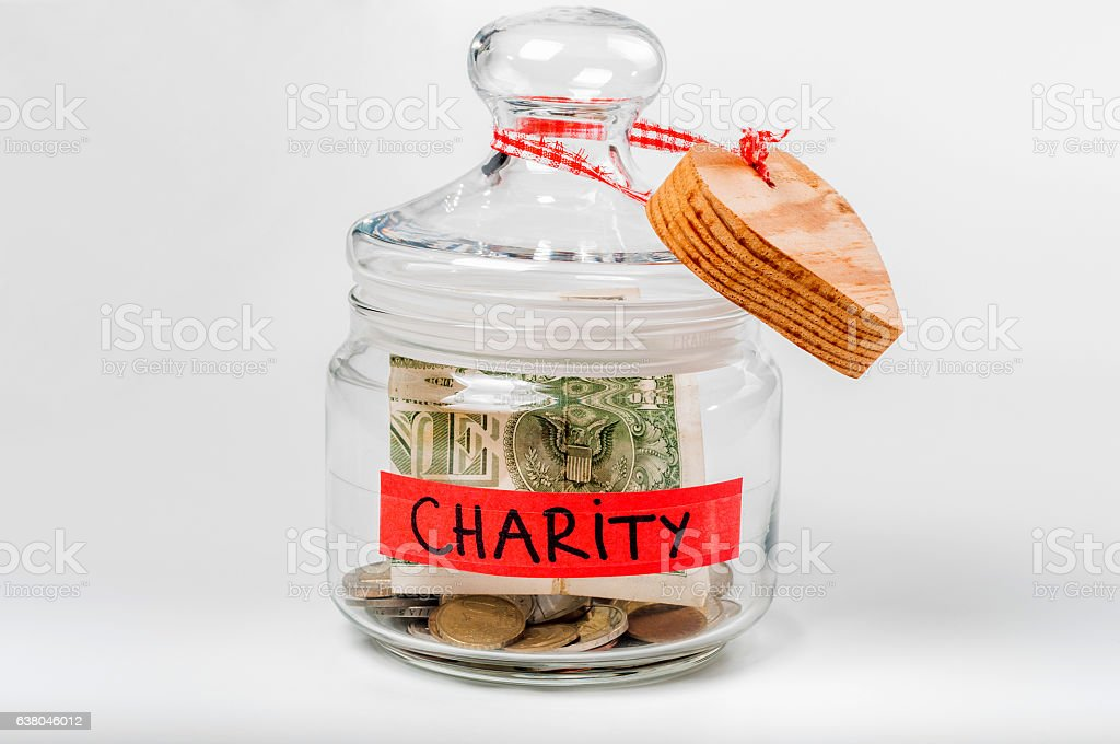 Jar with money with a charity label stock photo