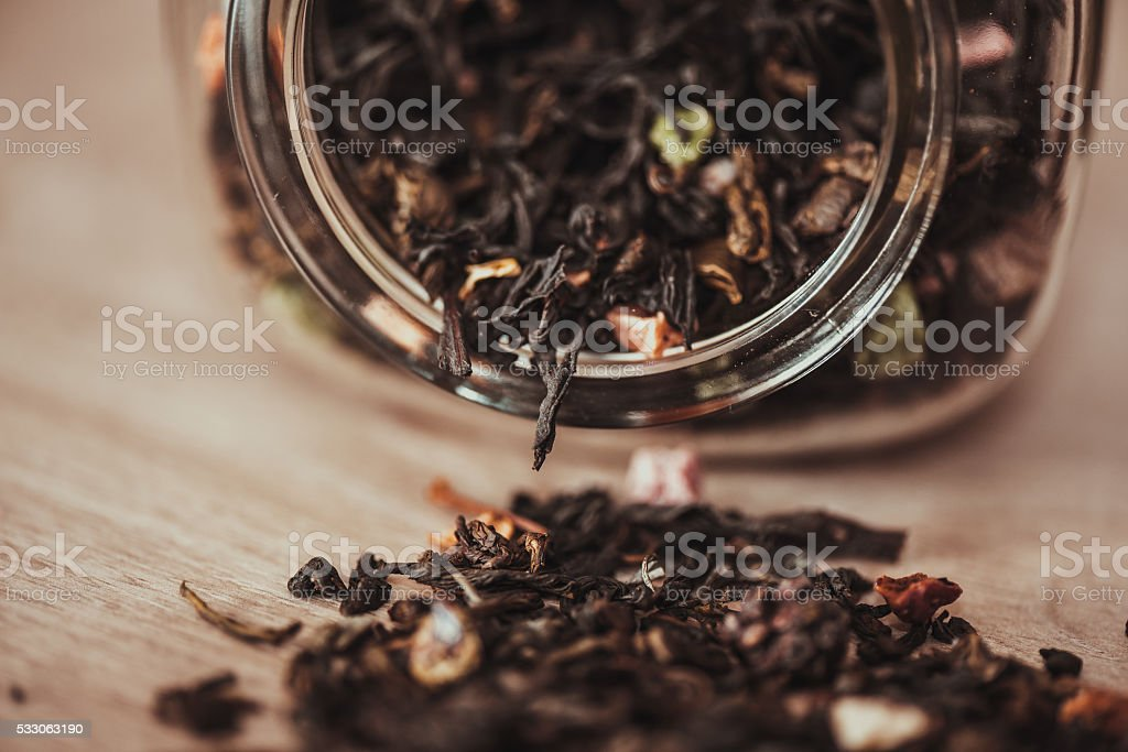 jar with scattering of tea stock photo