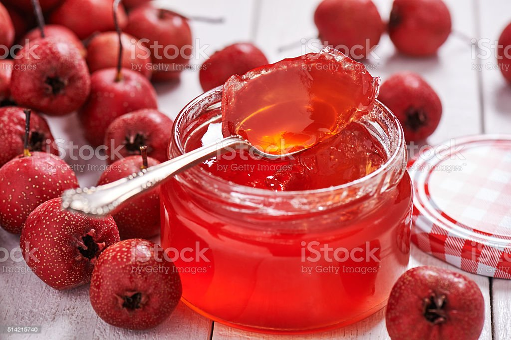 Jar with teaspoon jelly hawthorn stock photo