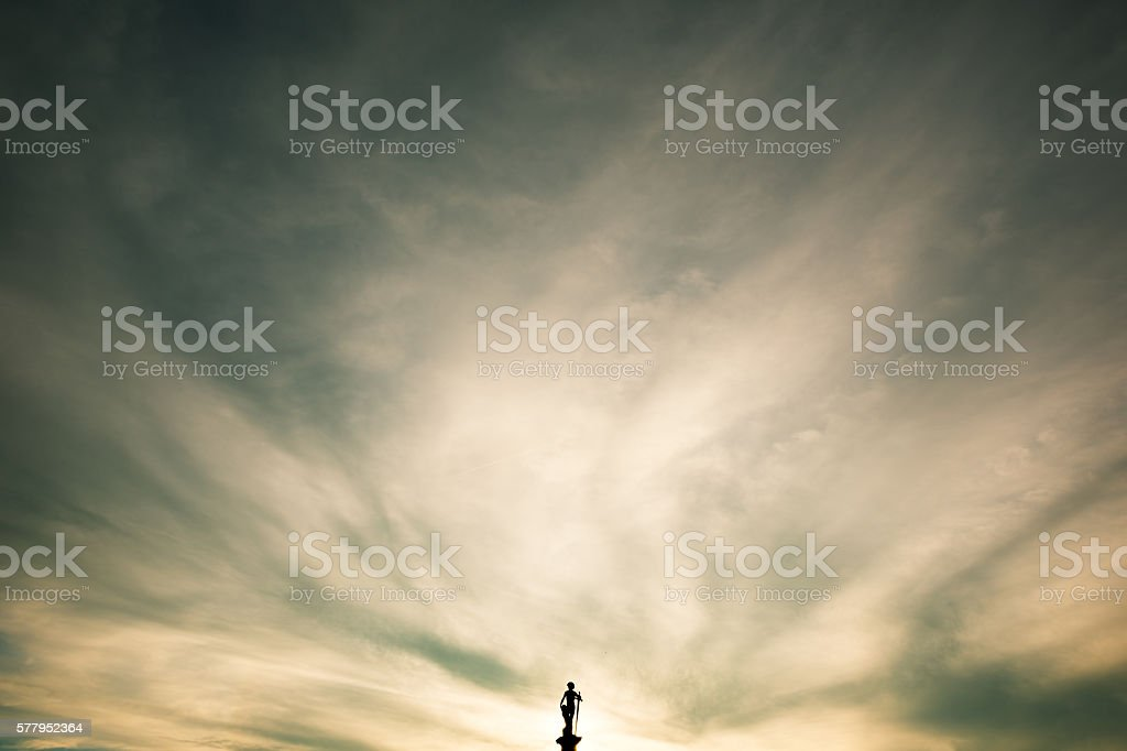 Jardin du Luxembourg, statue silhouette against dramatic sunset stock photo