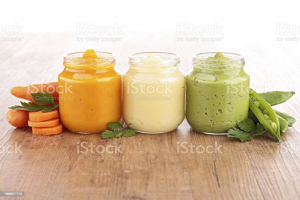 Jars filled with baby food made from veggies stock photo