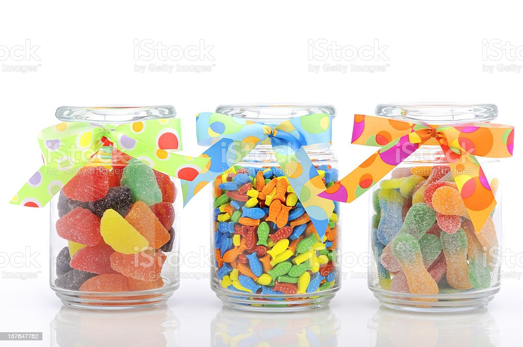 Jars filled with colorful candy stock photo
