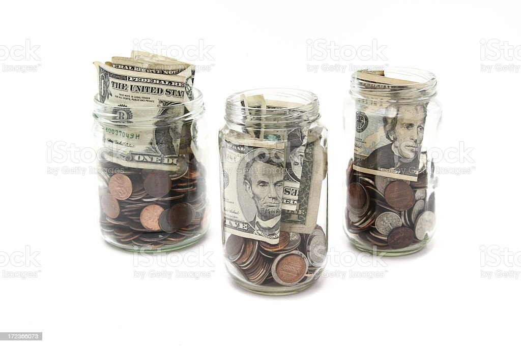 Jars of coins and currency stock photo