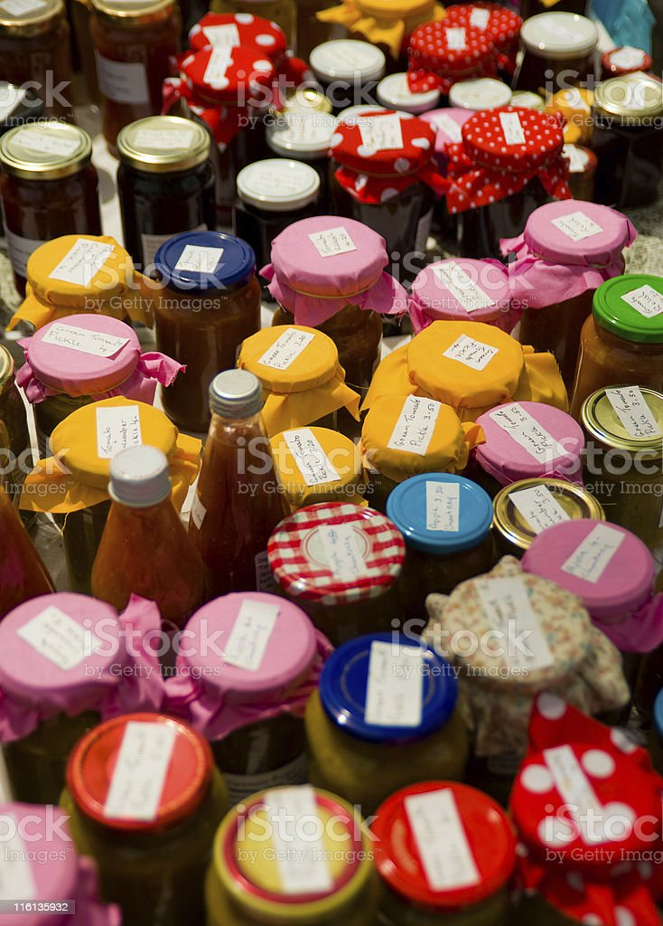 Jars of home-made jams and preserves at a local market royalty-free stock photo