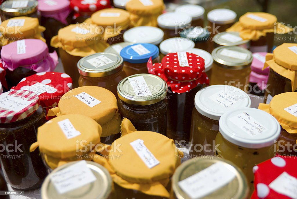 Jars of home-made preserves at local market stall stock photo