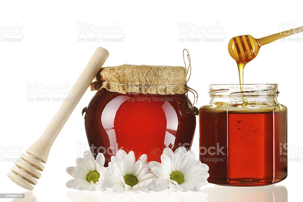 Jars of honey and dipper royalty-free stock photo