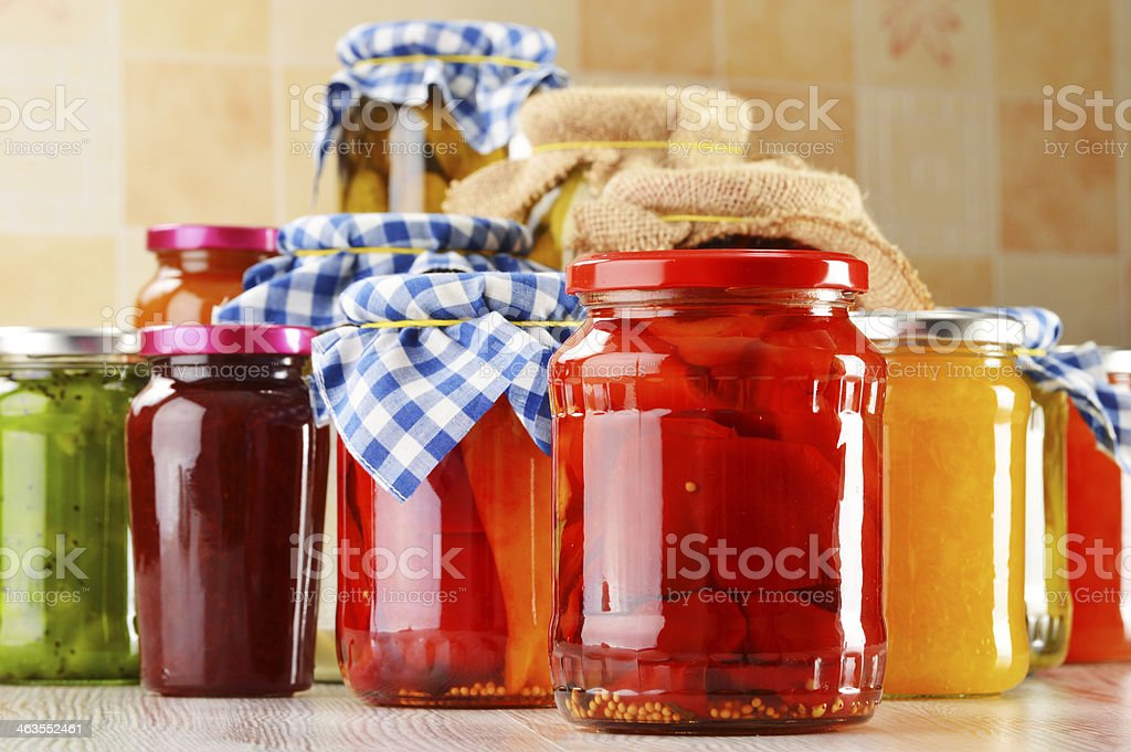 Jars of marinated food. Pickled vegetables and jams stock photo