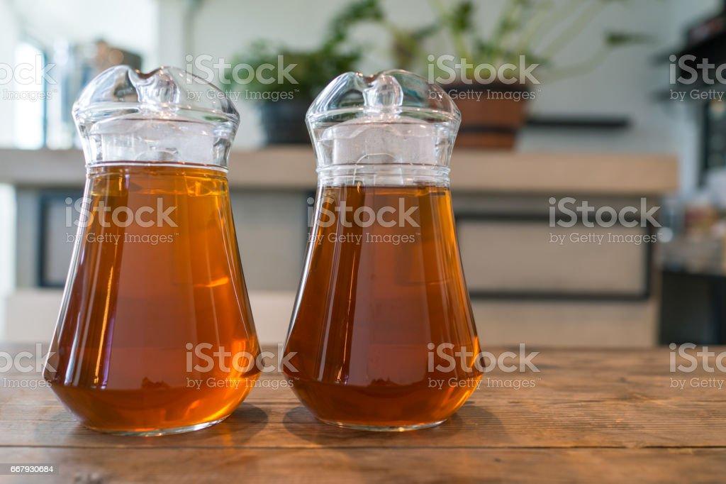 jars of sweet bael juice herb healthy on wood table stock photo
