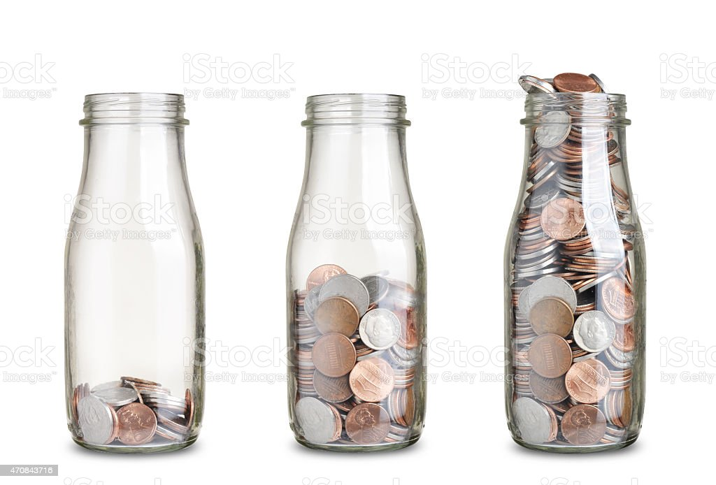 jars with coins stock photo