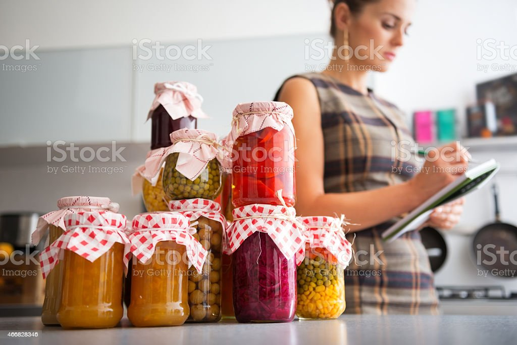 Jars with pickled vegetables on table. Closeup stock photo