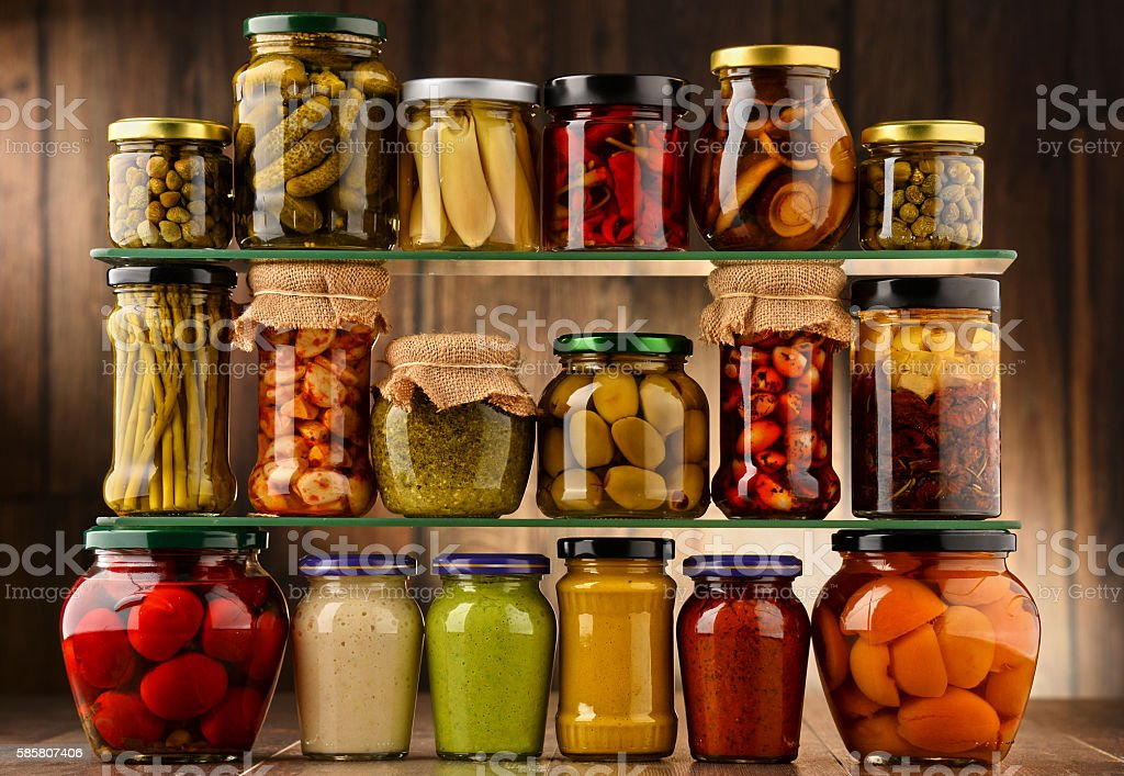 Jars with variety of pickled vegetables. stock photo