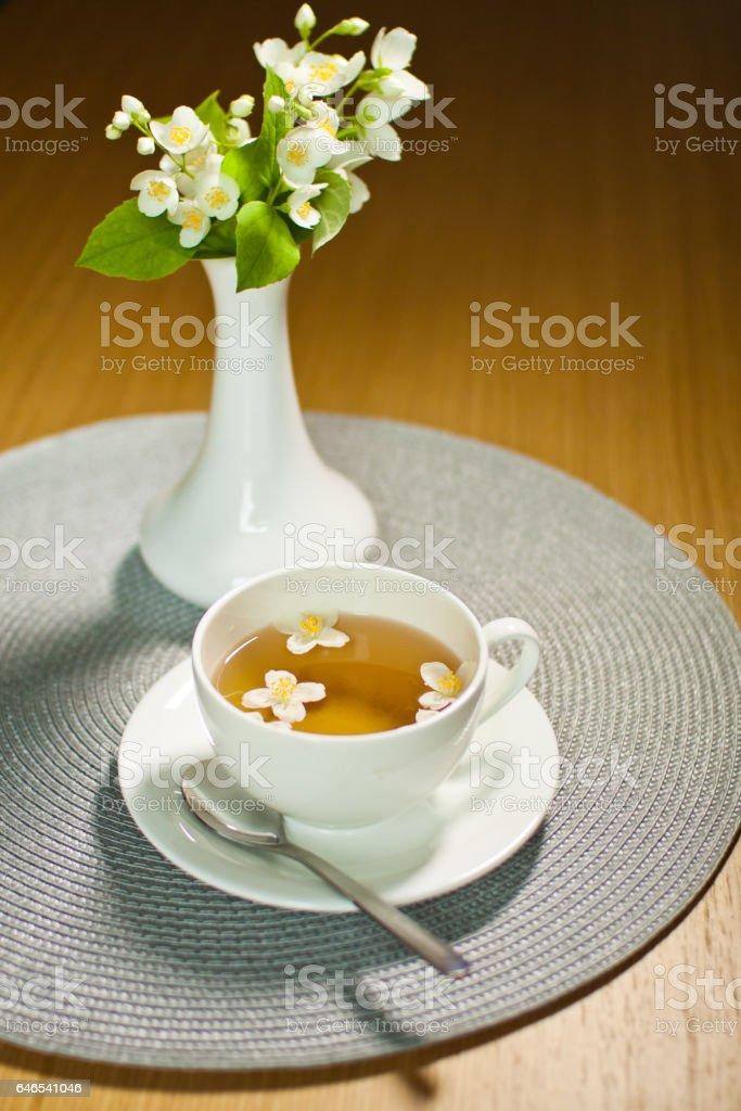 Jasmin green tea with flowers stock photo