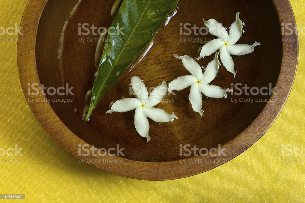 Jasmine flowers in wooden bowl royalty-free stock photo