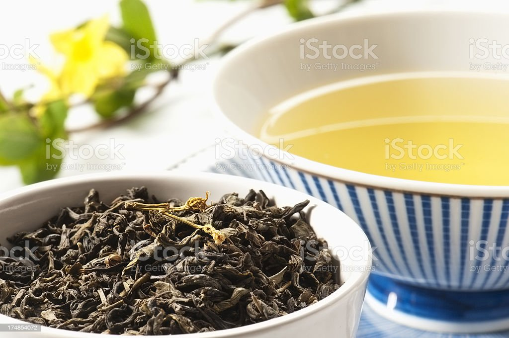 Jasmine Green Tea leaves and a cup of green tea stock photo