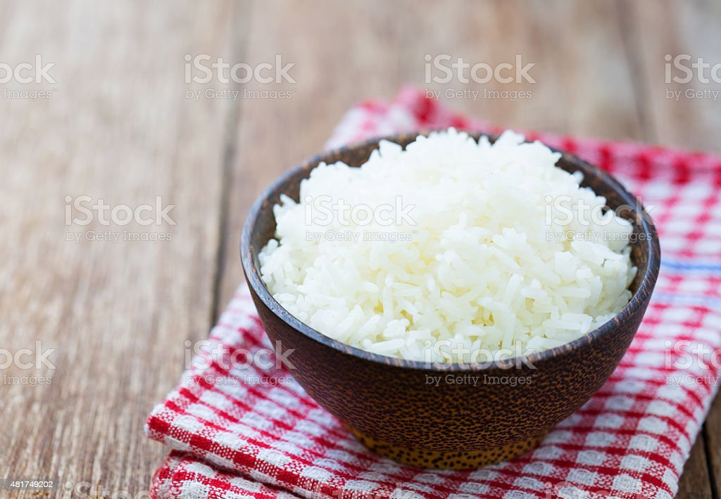 Jasmine rice in a  bowl on wood table stock photo