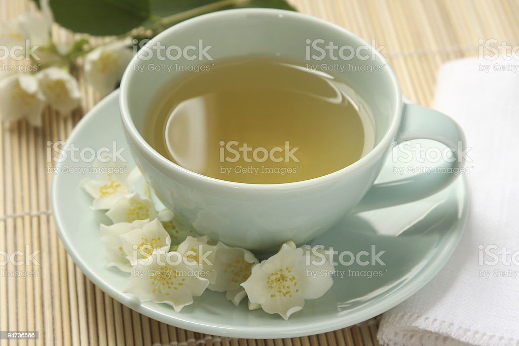 Jasmine tea and flowers royalty-free stock photo