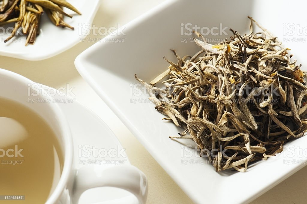 Jasmine tea leaves behind cup of tea royalty-free stock photo