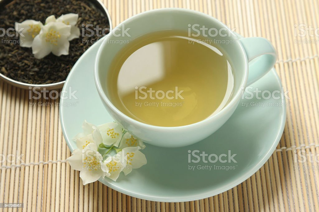 Jasmine tea with leaves royalty-free stock photo