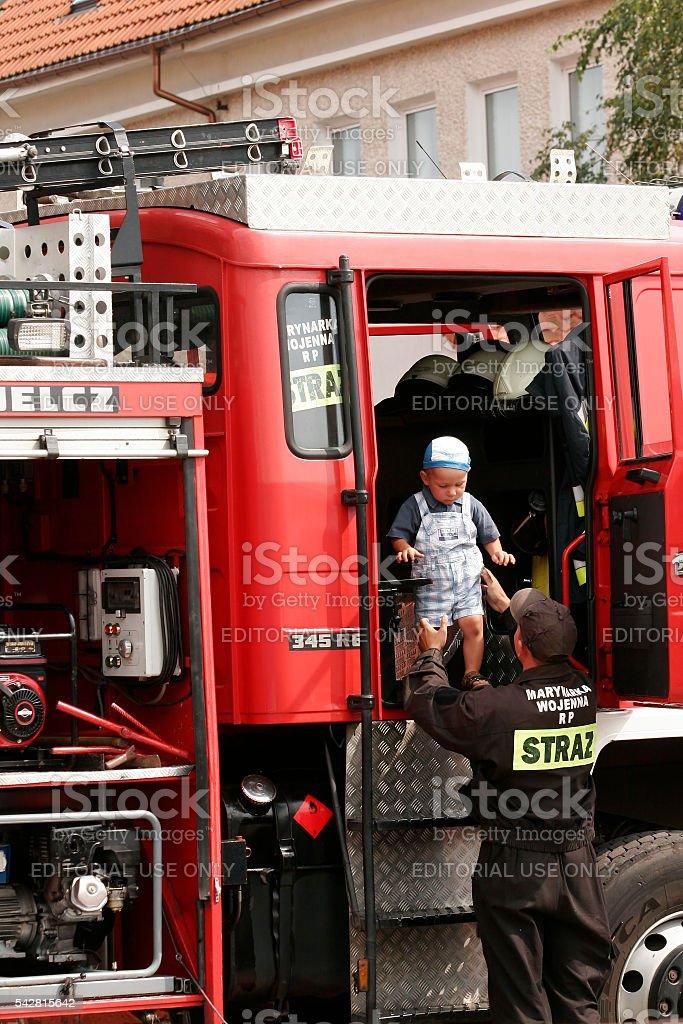 Jastarnia , Poland , August 15, 2007 : Firefighter shows car fire stock photo