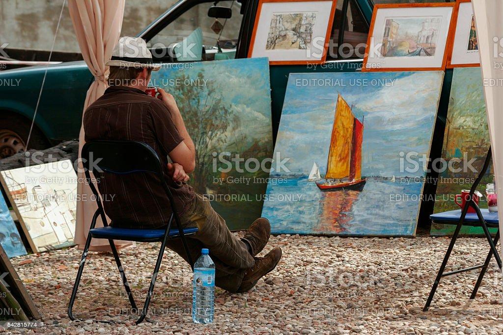 Jastarnia , Poland , August 15 , 2007: street vendor admires image stock photo