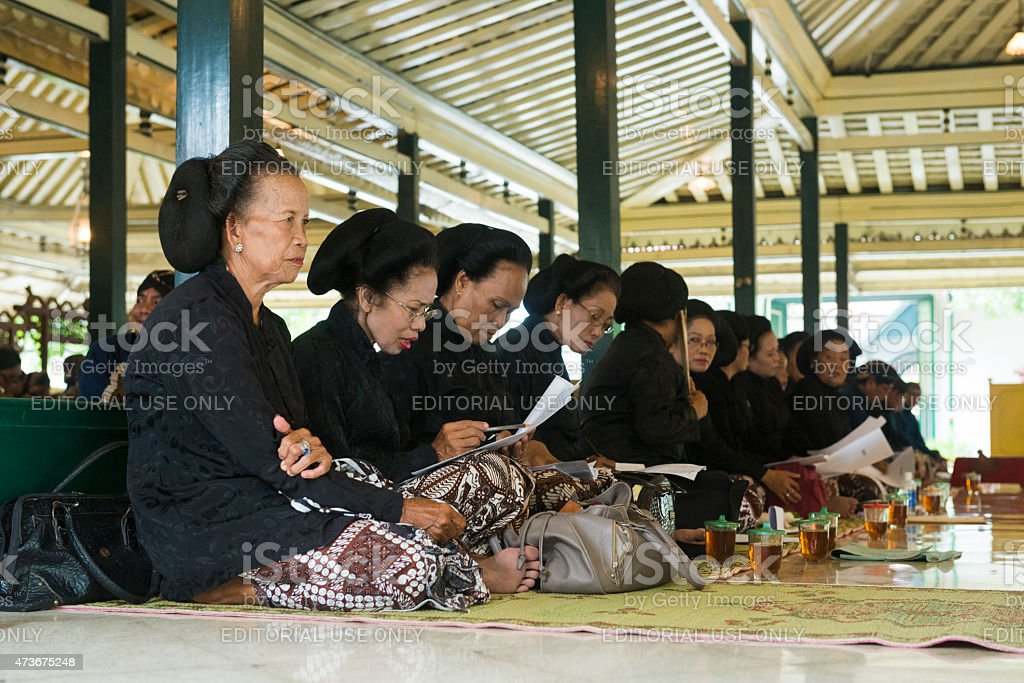 Javanese Women Sit Preparing to Sing at Yogyakarta Palace Ceremony stock photo