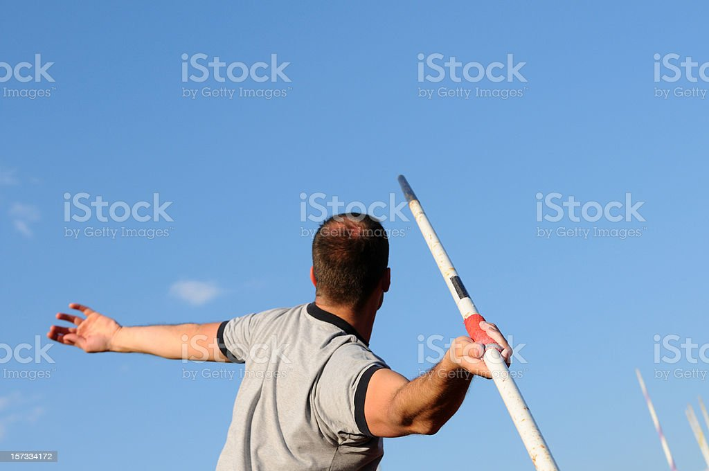 Javelin thrower in the action stock photo