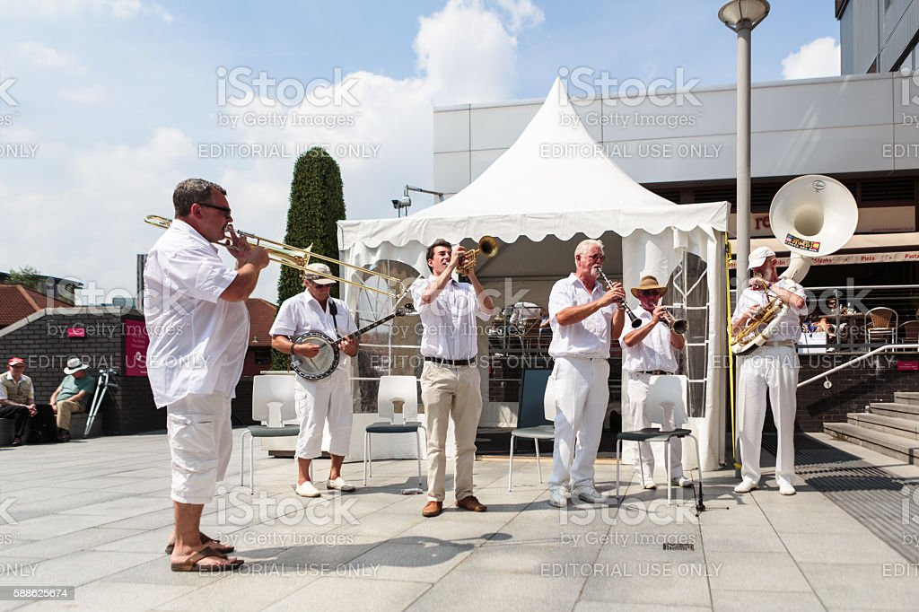 Jazz band playing in front of white marquis stock photo