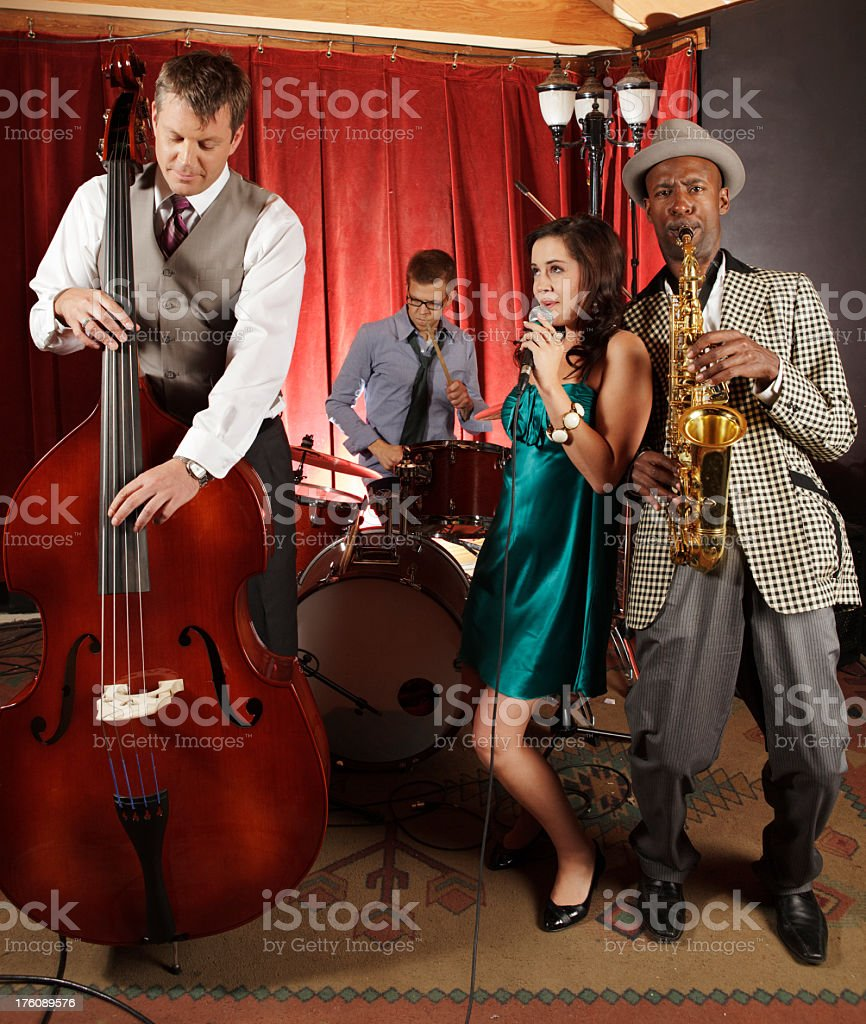 Jazz band with female singer playing at a night club stock photo