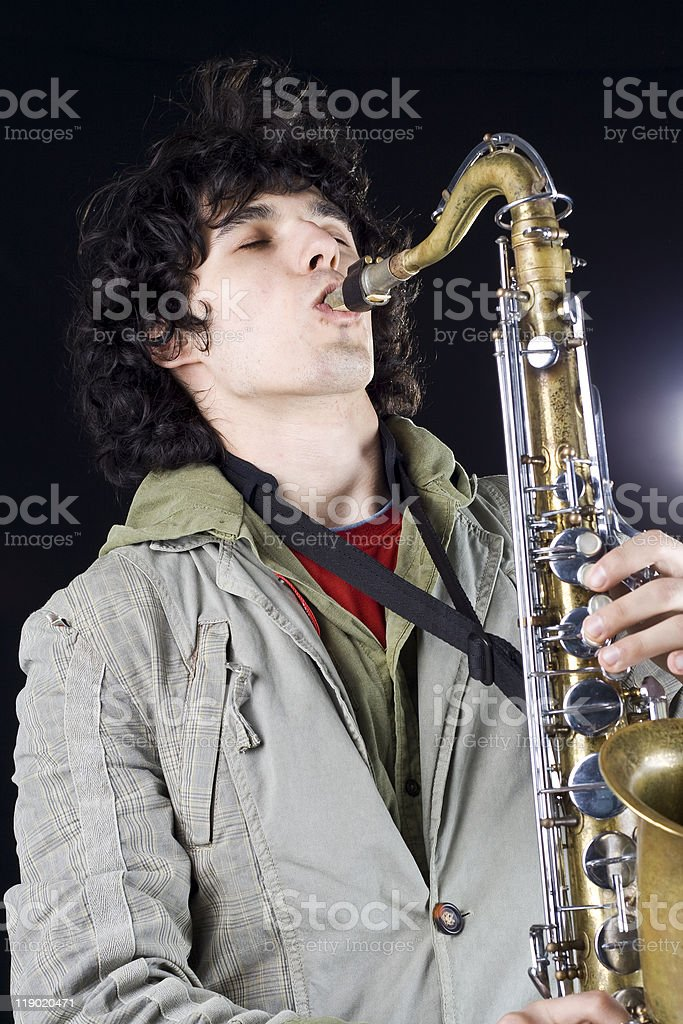 jazz saxophone player on a black background stock photo