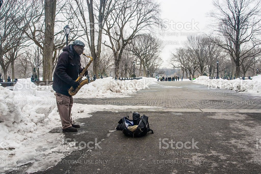Jazz saxophonist in New York City's Central Park stock photo