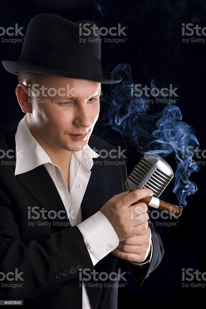 Jazzman and retro microphone royalty-free stock photo