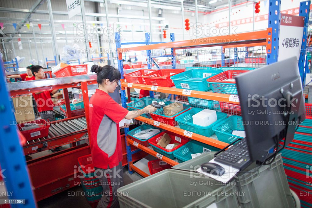 JD.com staff at Northeast China based Gu'an warehouse distribution facility stock photo
