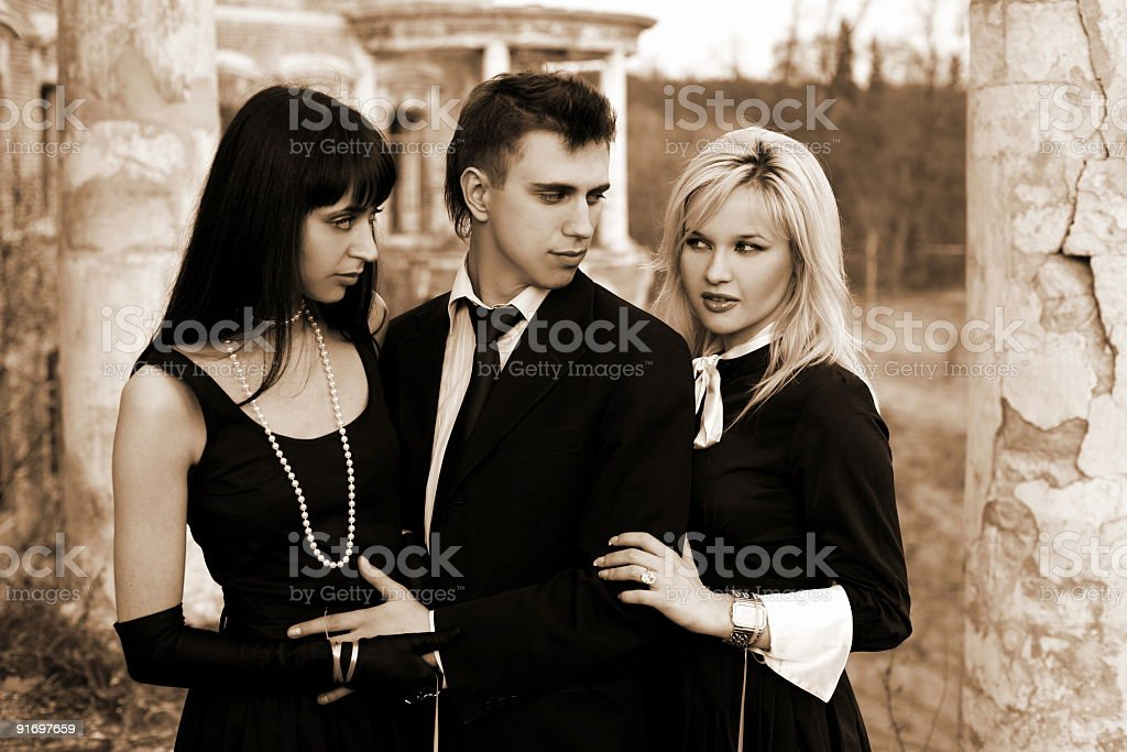 jealousy - two girl and man beside old house royalty-free stock photo
