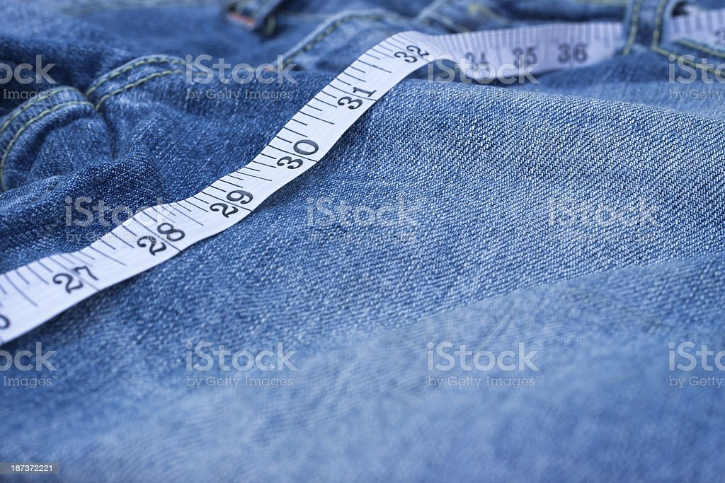 jean and scales tape stock photo