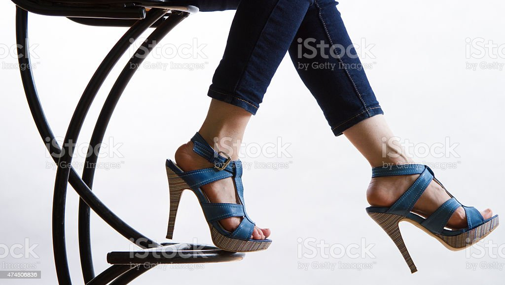 Jeans and high heeled shoes stock photo