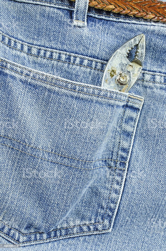 Jeans Back Pocket and Pliers royalty-free stock photo