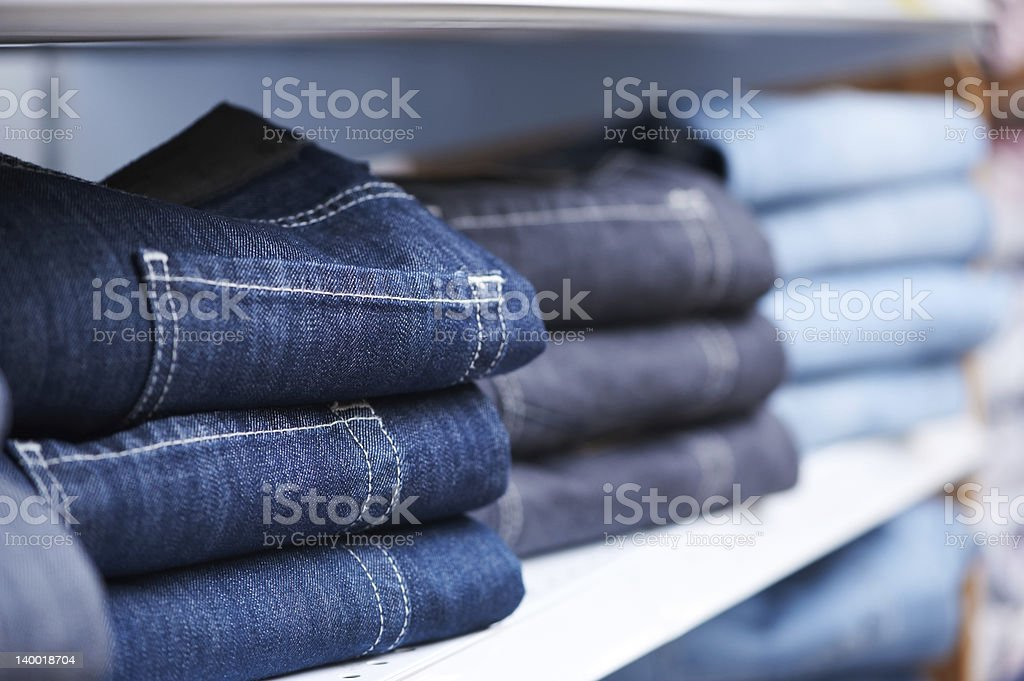 jeans clothes on shelf in shop stock photo