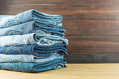 Jeans on a wooden background.